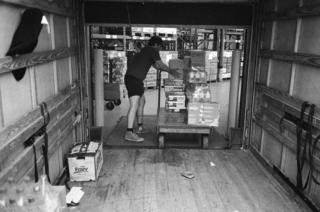 Food bank staff member loads supplies from Canadas largest food bank warehouse, Moisson Montreal. Photo: Aaron Vansintjan