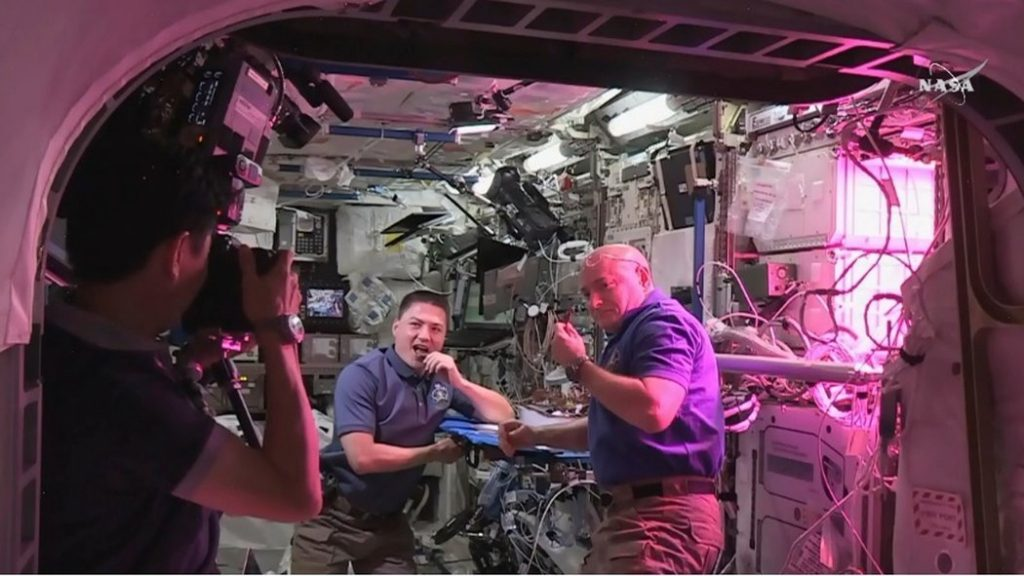 Astronauts eat the first lettuce grown in space at the International Space Station. Source: NASA