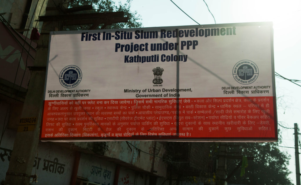 Banner at the entrance of the Kathputli colony.
